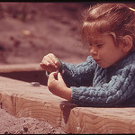 Little girl on the country fence.jpg